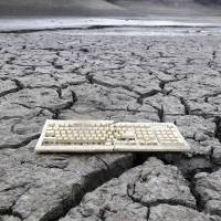 Photo - AP10ThingsToSee - A discarded computer keyboard lies on the dry, cracked bed of the Almaden Reservoir in San Jose, Calif. on Friday, Feb. 7, 2014 during the state's worst drought in recorded history. (AP Photo/Marcio Jose Sanchez)