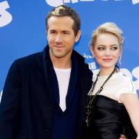 Photo - FILE - This March 10, 2013 file photo shows actors Ryan Reynolds, left, and Emma Stone at