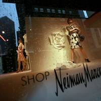 Photo - FILE - In this March 11, 2009, file photo, pedestrians pass by the windows of the Neiman Marcus store in Dallas. Neiman Marcus Group Ltd. said Thursday, Jan. 16, 2014, that customers' Social Security numbers and birthdates to its knowledge were not stolen in a security breach that happened over the holiday season. (AP Photo/Tom Pennington, File)