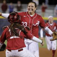 Photo - Alabama's Jackie Traina reacts after beating Arizona State during a Women's College World Series game at ASA Hall of Fame Stadium in Oklahoma City, Friday, June 1, 2012.  Photo by Bryan Terry, The Oklahoman