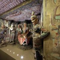 Photo - A full scale replica cave from the 8th century that contains the Bodhisattva of the Mogao Caves is presented in