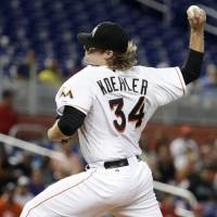 Photo - Miami Marlins starting pitcher Tom Koehler throws in the first inning during a baseball game against the St. Louis Cardinals, Monday, Aug. 11, 2014, in Miami. (AP Photo/Lynne Sladky)