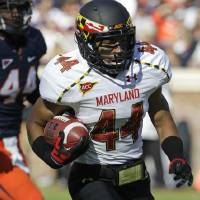 Photo -   Maryland running back Justus Pickett (44) heads to the end zone for a score during an NCAA college football game at Scott Stadium in Charlottesville, Va., Saturday, Oct. 13, 2012. (AP Photo/Steve Helber)