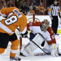 Photo - Florida Panthers' Jose Theodore, right, blocks a shot by Philadelphia Flyers' Danny Briere during the second period of an NHL hockey game, Thursday, Feb. 7, 2013, in Philadelphia. (AP Photo/Matt Slocum)