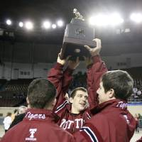 Photo - Tuttle celebrates their championship at the state wrestling championships at the State Fair Arena in Oklahoma City, Saturday, Feb. 25, 2012. Photo by Sarah Phipps, The Oklahoman