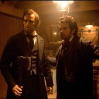 Photo - This film image released by 20th Century Fox shows Benjamin Walker portraying Abraham Lincoln, left, and Dominic Cooper portraying Henry Sturgis in a scene from