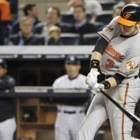 Photo -   Baltimore Orioles' Ryan Flaherty swings on a home run during the third inning of Game 3 of the Orioles' American League division baseball series against the New York Yankees on Wednesday, Oct. 10, 2012, in New York. (AP Photo/Bill Kostroun)