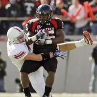 Photo - OU's  Ryan  Reynolds (4) tackles Baron Batch (25) of Texas Tech during the college football game between the University of Oklahoma Sooners (OU) and the Texas Tech University Red Raiders (TTU) at Jones AT&T Stadium in Lubbock, Texas, Saturday, Nov. 21, 2009. Photo by Nate Billings