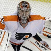 Photo - In this April 7, 2012, photo Philadelphia Flyers goalie Sergei Bobrovsky keeps his eye on the action during an NHL hockey game against the Pittsburgh Penguins in Pittsburgh. So much has changed with the Columbus NHL franchise that maybe they should be called the New Jackets. Brandon Dubinsky, Artem Anisimov, Bobrovsky, Nick Foligno and Tim Erixon, along with several other unfamiliar faces joining the club for the first time, will undoubtedly play important roles in the young team's reconstruction. (AP Photo/Gene J. Puskar)