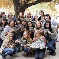 Photo - The Edmond Santa Fe High School yearbook staff includes, front row, from left, Millan Peterson, Heather Hutton (yearbook alumni) and editor-in-chief Adrianna Doyal. Second row, Kendra Lairson, Kyleigh Hearon, Amanda Kear, Dylan Freitas, copy editor Kysha Miller, photography editor Andree Miller, Taylor Dearneal. Back row: Callie Maupin, copy editor Alice Barrett, Maddie Freedman, Chloe Reid, Danielle Secrease, index editor McKenna Howard, Destini Riley. Photo by Paige White, For The Oklahoman