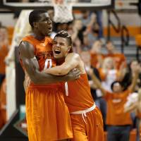 Photo - Oklahoma State's Cezar Guerrero (1) and Oklahoma State's Jean-Paul Olukemi (0) celebrate during an NCAA college basketball game between the Oklahoma State University Cowboys (OSU) and the University of Texas-San Antonio Roadrunners at Gallagher-Iba Arena in Stillwater, Okla., Wednesday, Nov. 16, 2011. Photo by Bryan Terry, The Oklahoman