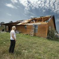 Photo - Kara Stanley shows damage to her home which doubled as the Pug Sanctuary on Thursday, June 9, 2011, in Dibble, Okla.  Pug Sanctuary Inc.'s facility was heavily damaged in May 24 and Stanley wants to rebuild. Photo by Steve Sisney, The Oklahoman ORG XMIT: KOD