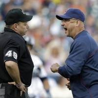 Photo - FILE - In this June 8, 2013 file photo, Cleveland Indians manager Terry Francona argues with home plate umpire Andy Fletcher during the eighth inning of a baseball game against the Detroit Tigers in Detroit. Francona was ejected from the game. With baseball's expanded replay rule this season, those colorful, saliva-trading tirades Bobby Cox and Lou Piniella made famous could very well be replaced by far more civilized behavior. (AP Photo/Carlos Osorio, File)