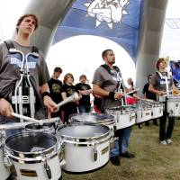 Photo - Members of the SWOSU drum line host a clinic for high school bands as part of Band Day activities at the state fair on Monday, Sep. 17, 2012.  Drummer at left is Josh Hoffert, a freshman at Southwestern Oklahoma State University.  Photo by Jim Beckel, The Oklahoman.