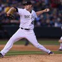 Photo - Colorado Rockies starting pitcher Tyler Matzek works against the Atlanta Braves in the sixth inning of a baseball game in Denver on Wednesday, June 11, 2014. (AP Photo/David Zalubowski)