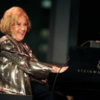 Photo - FILE - In this March 19, 2008 file photo, Marian McPartland smiles while playing the piano during a celebration of her 90th birthday in New York. McPartland, 95, the legendary jazz pianist and host of the National Public Radio show