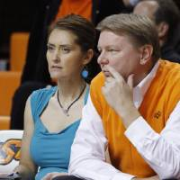 Photo - This Nov. 9, 2011 photo shows Oklahoman State women's basketball coach Kurt Budke and assistant coach Miranda Serna during an an exhibition women's NCAA college basketball game against Fort Hays State, in Stillwater, Okla.  Budke and Serna were killed when the single-engine plane they were riding in during a recruiting trip crashed near a wildlife management area in central Arkansas. The university said the pair died in the crash Thursday night, Nov. 17, 2011. PHOTO BY BRYAN TERRY, THE OKLAHOMAN