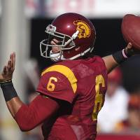 Photo - Southern California quarterback Cody Kessler passes during they first half of an NCAA college football game against Fresno State, Saturday, Aug. 30, 2014, in Los Angeles. (AP Photo/Mark J. Terrill)