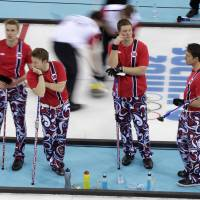 Photo - Norway player, from left, Haavard Vad Petersson, Torger Nergaard, Christoffer Svae, and skip Thomas Ulsrud wait for their turn to throw during men's curling competition against Denmark at the 2014 Winter Olympics, Monday, Feb. 17, 2014, in Sochi, Russia. (AP Photo/Robert F. Bukaty)
