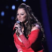 Photo - FILE - In this April 26, 2012, file photo, singing superstar Jenni Rivera performs during the Latin Billboard Awards in Coral Gables, Fla. Authorities in Mexico say the wreckage of a small plane believed to be carrying Rivera has been found on Sunday, Dec. 9, 2012, and there are no apparent survivors. (AP Photo/Lynne Sladky, file)