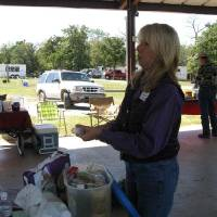 Photo - OETRA President Teri Wyatt demonstrates what should be in your trail riding first aid kit during last year's Horse Camping 101 Clinic. (Photo provided)