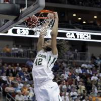 Photo -   FILE - This March 24, 2012 file photo shows Baylor center Brittney Griner dunking the ball during the second half of an NCAA women's tournament regional semifinal college basketball game against Georgia Tech, in Des Moines, Iowa. Griner became only the second four-time All-American when she was honored by The Associated Press on Tuesday, March 27, 2012. (AP Photo/Charlie Neibergall, File)