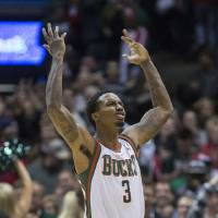 Photo -   Milwaukee Bucks' Brandon Jennings reacts to his game winning shot at the buzzer to defeat the Cleveland Cavaliers 105-102 in the second half of an NBA basketball game, Saturday Nov. 3, 2012 in Milwaukee. (AP Photo/Tom Lynn)