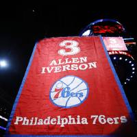 Photo - Former Philadelphia 76er Allen Iverson, center, watches as a banner with his number is raised during a retirement ceremony at halftime of an NBA basketball game between the 76ers and the Washington Wizards, Saturday, March 1, 2014, in Philadelphia. (AP Photo/Matt Slocum)