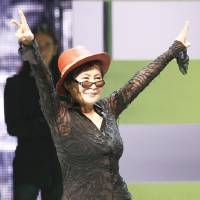 "Photo - Yoko Ono acknowledges the crowd at the launch of ""The  Beatles: Rock Band"" Xbox game Monday. AP PHOTO"