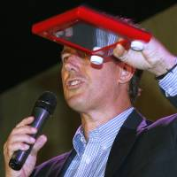 Photo -   Republican presidential candidate, former Pennsylvania Sen. Rick Santorum holds an Etch A Sketch during a rally in Mandeville, La., Wednesday, March 21, 2012. (AP Photo/Bill Haber)