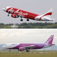 Photo -   In this combination of three undated photos, planes of Japan's low-cost airlines, from top, AirAsia Japan, Peach Aviation and Jetstar, are shown in Japan. Japan has a reputation for loving expensive things like overpriced real estate, gourmet melons and luxury brands. But the nation is finally discovering the joy of flying cheap, with the arrival this year of three low-cost carriers. The takeoff of AirAsia Japan, Peach Aviation and Jetstar Japan could change lifestyles. (AP Photo/Kyodo News) JAPAN OUT, MANDATORY CREDIT, NO LICENSING IN CHINA, FRANCE, HONG KONG, JAPAN AND SOUTH KOREA