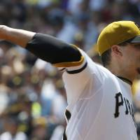 Photo - Pittsburgh Pirates starting pitcher Charlie Morton throws against the San Diego Padres in the first inning of a baseball game on Sunday, Aug. 10, 2014, in Pittsburgh. (AP Photo/Keith Srakocic)