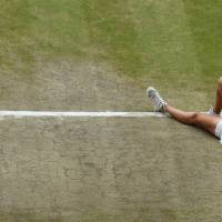 Photo - Petra Kvitova of Czech Republic celebrates defeating Eugenie Bouchard of Canada in their women's singles final at the All England Lawn Tennis Championships in Wimbledon, London, Saturday, July 5, 2014. (AP Photo/Gareth Fuller, Pool)