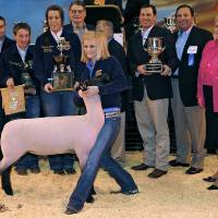 Photo - Charlcey Vinyard (CQ) CHARLCEY VINYARD poses with her Grand Champion lame during the Oklahoma Youth Expo Sale of Champions at State Fair Park in Oklahoma City on Monday, March 23, 2009. The lamb sold for $22,000 to Touchstone Energy. Behind Charlcey is Cooper Newcomb, Carson Vinyard, McKenzie Clifton, Ted Farris, Bob Newcomb (partially hidden), David Henry, Kevin Cates and Lt. Governor Jari Askins. PHOTO BY JOHN CLANTON, THE OKLAHOMAN ORG XMIT: KOD