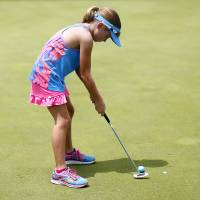 Photo -  Kate Melton putts during the 11th annual parent-child tournament at KickingBird Golf Course in Edmond. She was playing with her father in the tournament. PHOTO BY SARAH PHIPPS, THE OKLAHOMAN   SARAH PHIPPS -
