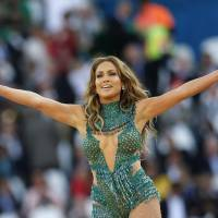 Photo - United States singer Jennifer Lopez performs during the 2014 World Cup opening ceremony ahead of the group A soccer match between Brazil and Croatia, the opening game of the tournament, in the Itaquerao Stadium in Sao Paulo, Brazil, Thursday, June 12, 2014. (AP Photo/Frank Augstein)