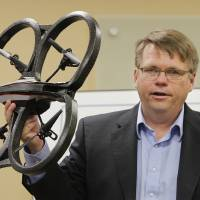 Photo -  James Grimsley, president and CEO of Design Intelligence Incorporated, holds up a quad copter while talking about drone research and development in Oklahoma during a meeting at the Tinker Business and Industrial Park Monday, April 28, 2014. Photo by Paul B. Southerland, The Oklahoman   PAUL B. SOUTHERLAND -  PAUL B. SOUTHERLAND