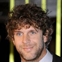 Photo - FILE - Billy Currington arrives at the 59th Annual BMI Country Awards in Nashville on in this Nov. 8, 2011 file photo. Currington was indicted Wednesday April 24, 2013 in Georgia on charges that he threatened bodily harm to a man older than 65.  (AP Photo/Evan Agostini, File)