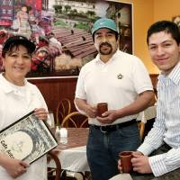 Photo - Owners of Cafe Antigua inside their restaurant, 1903 N Classen, Monday,  March 2, 2009.  From left, Elida Valdez, Benjamin Valdez and Luidgi Del Cid.   BY JIM BECKEL, THE OKLAHOMAN ORG XMIT: KOD