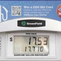 Photo - The price of CNG is shown at the OnCue Express at 1 NW 23 in Oklahoma City.  Photo By Paul Hellstern, The Oklahoman