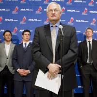 Photo -   Donald Fehr, left, executive director of the NHL players' association, talks to reporters following collective bargaining talks between the NHLPA and the NHL in Toronto on Thursday, Oct. 18, 2012. Players, from left, Detroit Red Wings' Daniel Cleary, Edmonton Oilers' Shawn Horcoff, Pittsburgh Penguins' Sidney Crosby, Carolina Hurricanes' Eric Staal and Phoenix Coyotes' Shane Doan listen in the background. (AP Photo/The Canadian Press, Chris Young)