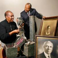 Photo - Currie Ballard,  an historian and local expert on African-American culture at Langston University and in central Oklahoma, donated items to the Oklahoma History Center in 2009. Receiving the pieces is Bruce Fisher, left, curator for the African-American exhibit at the Center.  The portraits are of Inman Page and his wife, Zelia. Inman Page was the first president of Langston University. The portraits previously hung in Page Elementary School in Guthrie.  Also donated were a pair of vintage movie projectors  and a projection screen used by Rev. S. S. Jones in the 1920s.  Photo by Jim Beckel, The Oklahoman