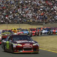 Photo -   Jeff Gordon (24) leads the pack during the NASCAR Sprint Cup Series auto race, Sunday, June 24, 2012, in Sonoma, Calif. (AP Photo/Ben Margot)