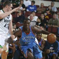 Photo - OKLAHOMA CITY THUNDER NBA BASKETBALL TEAM:  Oklahoma City Thunder's Jeff Green drives the ball against Minnesota Timberwolves' Kevin Love during an NBA basketball game Wednesday, Oct. 8, 2008, in Billings, Mont. (AP Photo/Billings Gazette, Paul Ruhter) ORG XMIT: MTBIL103