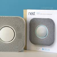 Photo - FILE - In this Tuesday, Oct.  1, 2013, file photo, the Nest smoke and carbon monoxide alarm is shown at the company's offices, in Palo Alto, Calif. Google said Monday, Jan. 13, 2014, it will pay $3.2 billion to buy Nest Labs, which develops high-tech versions of devices like thermostats and smoke detectors.  (AP Photo/Marcio Jose Sanchez)