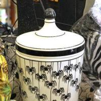 Photo - A porcelain urn decorated with black spiders is a modern way to incorporate Halloween into your decor. Sold at Scruples of Edmond. Photo by David McDaniel, The Oklahoman