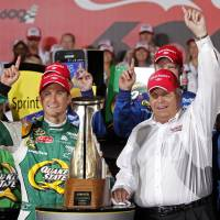Photo - FILE - In this file photo taken May 27, 2012, Kasey Kahne, left, and team owner Rick Hendrick, right, pose with the trophy in Victory Lane after winning the NASCAR Coca-Cola 600 Sprint Cup Series auto race in Concord, N.C. Kahne's contract runs through 2015, about the same time Chase Elliott will be ready for a promotion from the driver development program to the big leagues. Hendrick Motorsports has got to put Elliott somewhere, and there's no guarantee Jeff Gordon is going to smile his way into retirement and hand his seat over to Elliott. (AP Photo/Terry Renna, File)