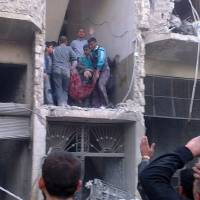 Photo - Citizen journalism image provided by Aleppo Media Center AMC which has been authenticated based on its contents and other AP reporting, Syrian citizens carry an injured man from a damaged building that was hit by a Syrian forces airstrike, on the al-Marjeh neighborhood, of Aleppo, Syria, Tuesday March 19, 2013. Syria's information minister says a chemical weapon fired by rebels on a village in the north of the country is the