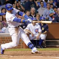Photo - Chicago Cubs' Javier Baez follows through on a home run off Milwaukee Brewers starting pitcher Kyle Lohse during the third inning of a baseball game Wednesday, Aug. 13, 2014, in Chicago. (AP Photo/Stacy Thacker)
