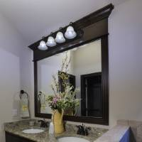 Photo - A double vanity adds function to the master bath of the home by First Oklahoma Construction at 709 Summit Hollow Drive in Norman's Summit Lake Villas addition.  STEVE SISNEY -